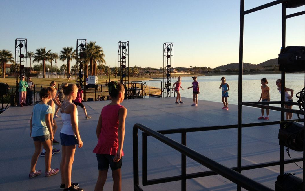 Kids dancing on outdoor stage at Estrella event