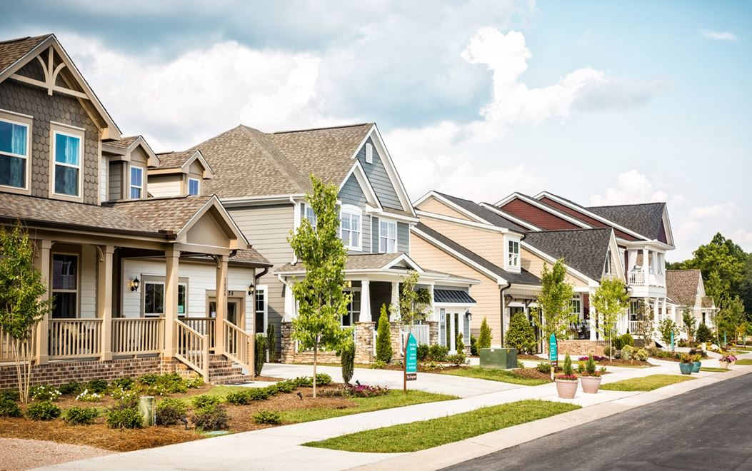 Row of model homes with covered front porches