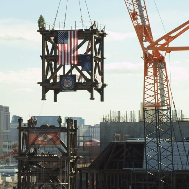 Construction of Symphony Park with American flag hanging from crane