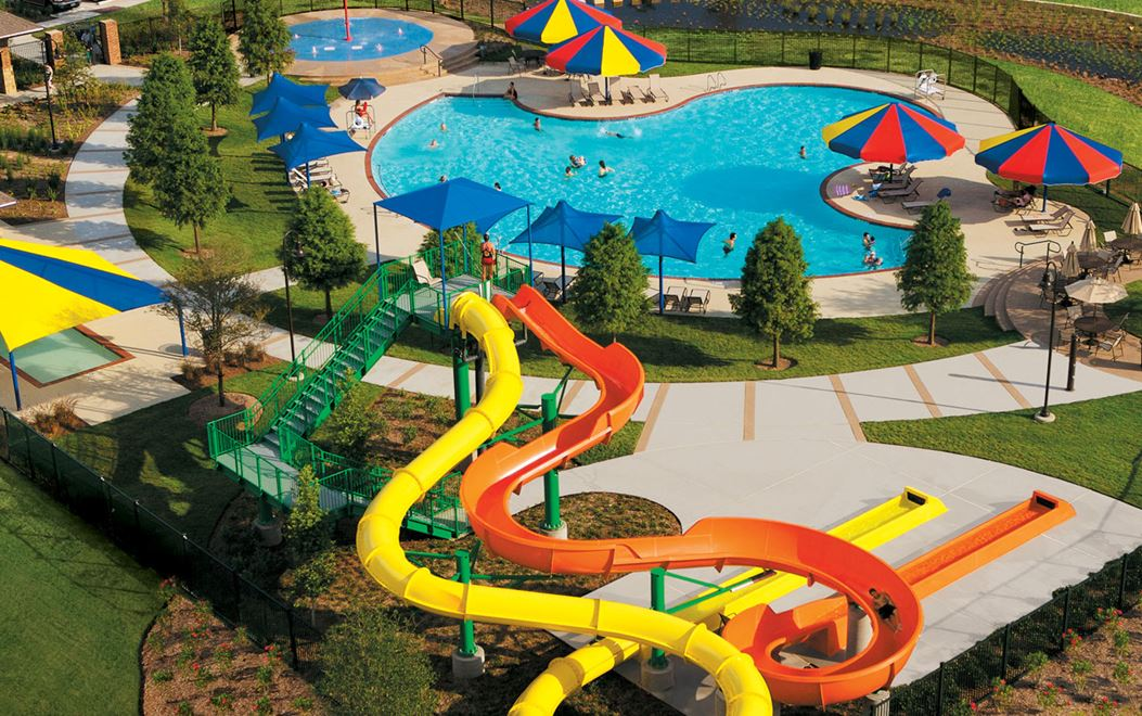 Aerial view of Cinco Ranch community pool with dual water slides