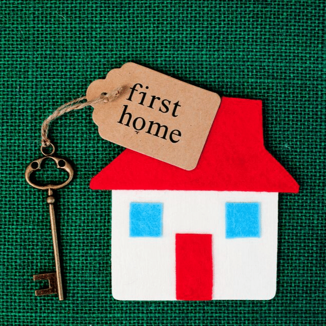 "Felt Cut-Out of Small White House with Red Roof and Door and Two Blue Windows with Antique Key and ""First Home"" Tag"
